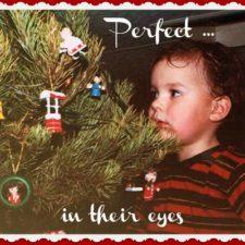 "ALT=""child hanging ornaments"""